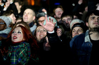 A girl in the crowd reaches out to Simon Neil of Biffy Clyro on stage in Princes Street Gardens.